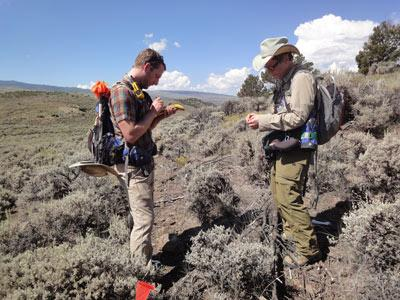 Two archaeologists using a GPS on a PAAC survey.