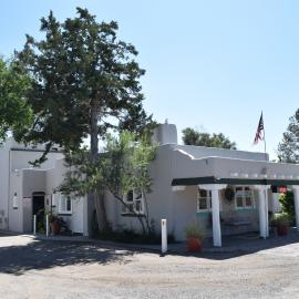 A photo of the Pueblo Revival-style Coronado Lodge in Pueblo.