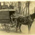 "Photo of a horse-drawn car. The side of the car has the words ""Volunteers of America - Relief Dept."" painted on the side, along with ""Phone Maple 790."" The driver is a young man dressed in a suit and hat. He is sitting in the car,holding the reins and posing for this photo."